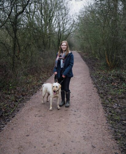Girl and Dog on woodland walk in Salcey Forest