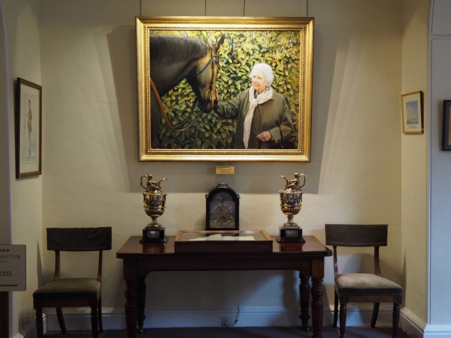 Photo of a painting of the Queen in Newmarket's Jockey Club Rooms