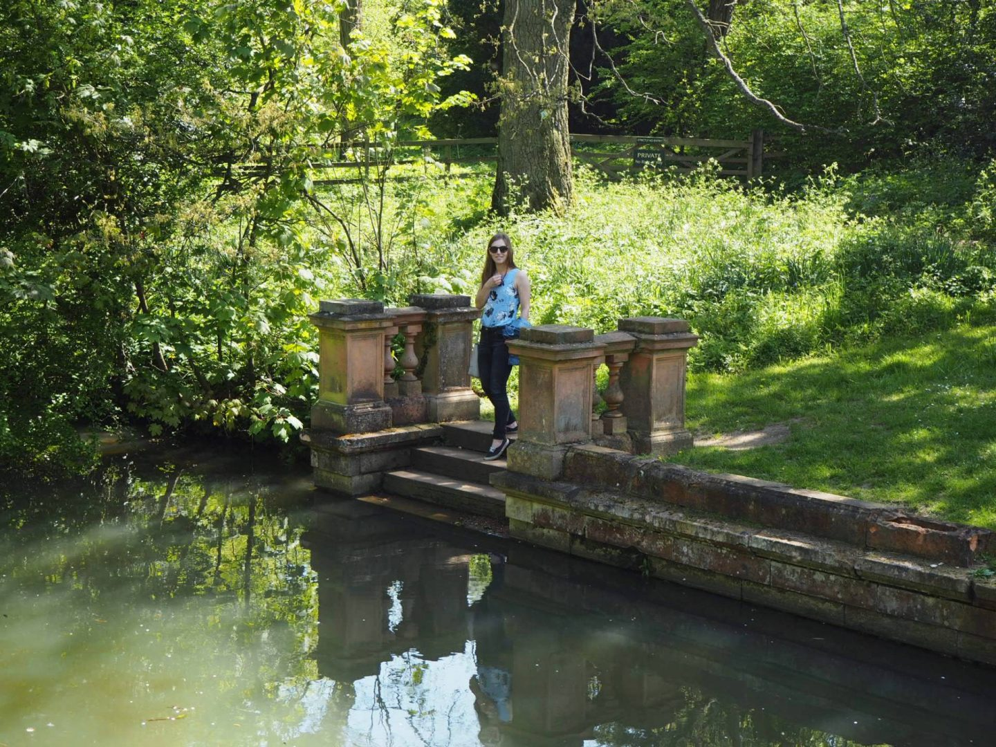 Girl by the water in Castle Ashby Gardens