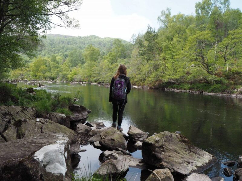 Walking along the river by Rogie Falls