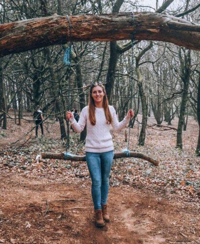 Girl on a rope swing in Aspley Woods