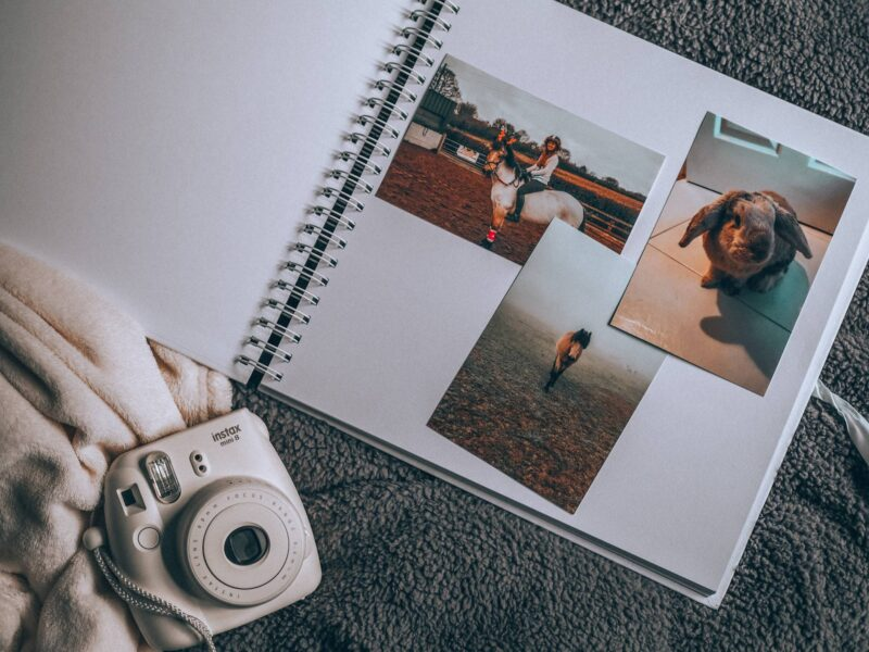 Instax camera and scrapbook for documenting special moments in life
