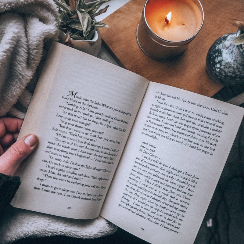 Close up of a book and a candle