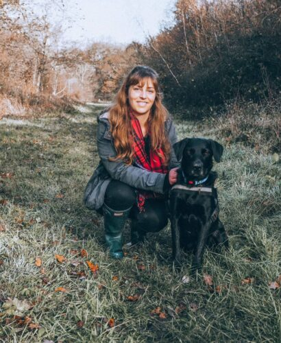 Girl and labrador in little linford woods