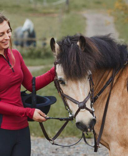 Kaia Equine founder Shannon wearing the Alba Base Layer alongside her pony, Beano