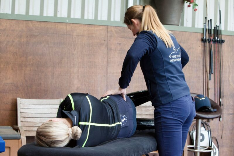 Nikki from Rider Elite Physiotherapy treating a horse rider