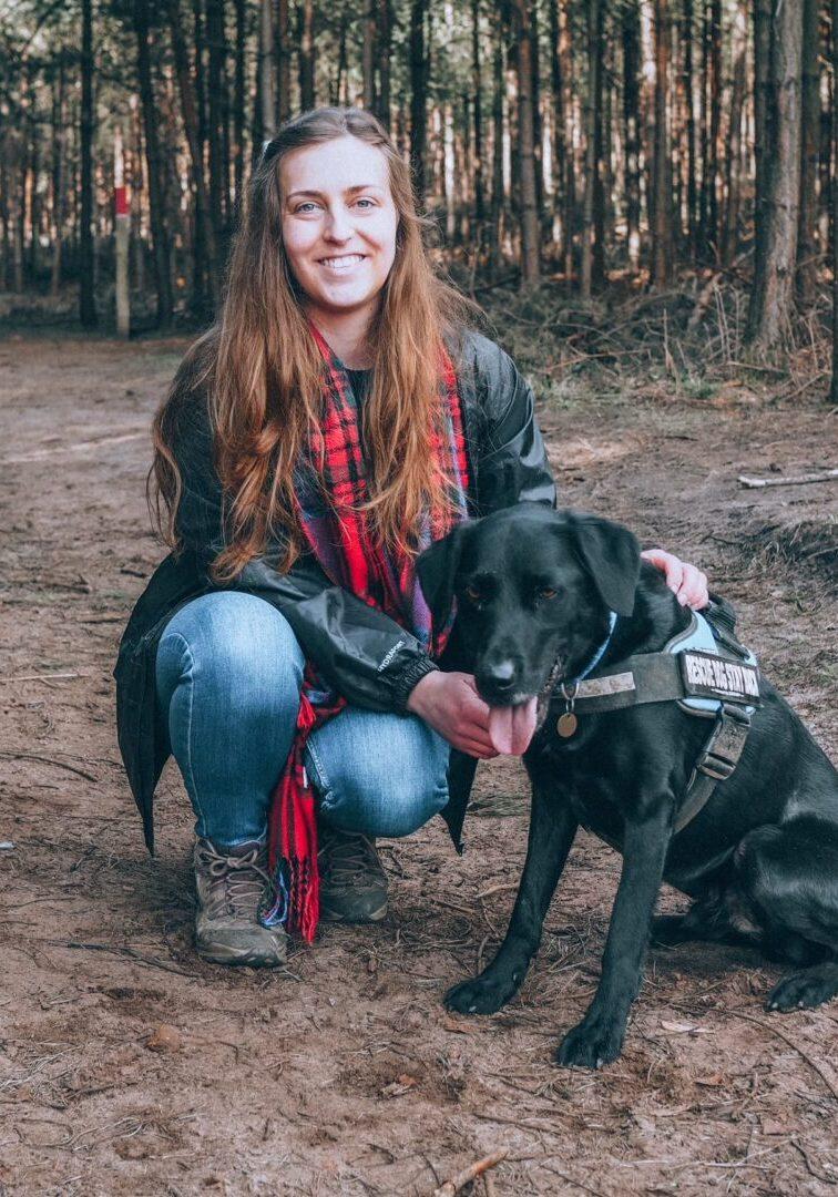 Girl walking a dog in Aspley Woods, Bedfordshire
